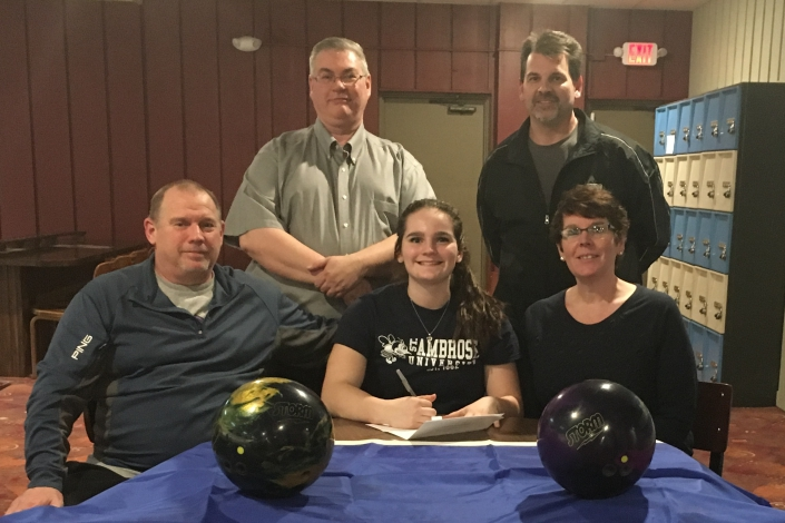 Christin Swank signs her letter of intent alongside her parents Jeff and Natalie and SAU coaches Eric Littig and Craig Crawfo